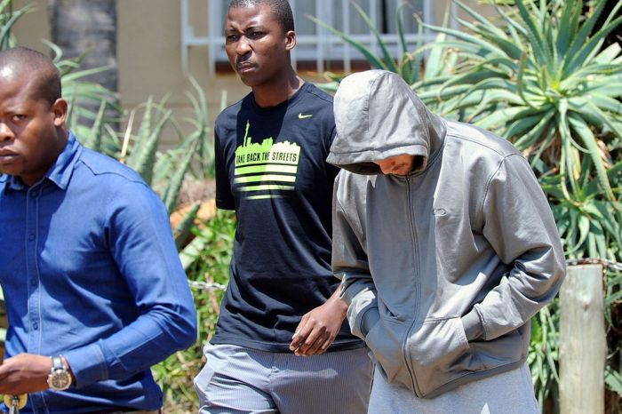 Oscar Pistorius leaves the Boschkop police station, Pretoria, after his arrest for the murder of his girlfriend Reeva Steenkamp (AP)