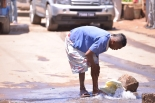 Washing (in the middle of the road)